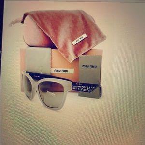 Miu Miu women's Sunglasses cat eye